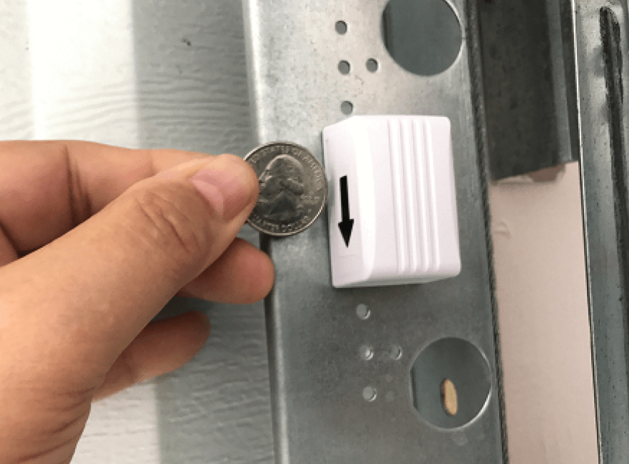 Comparing a wireless garage tilt sensor to a Florida quarter
